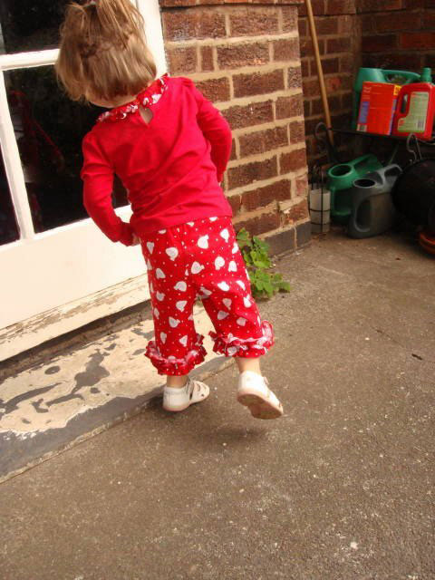 red chicken printed cotton trousers