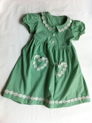 green gingham school dress with heart pockets