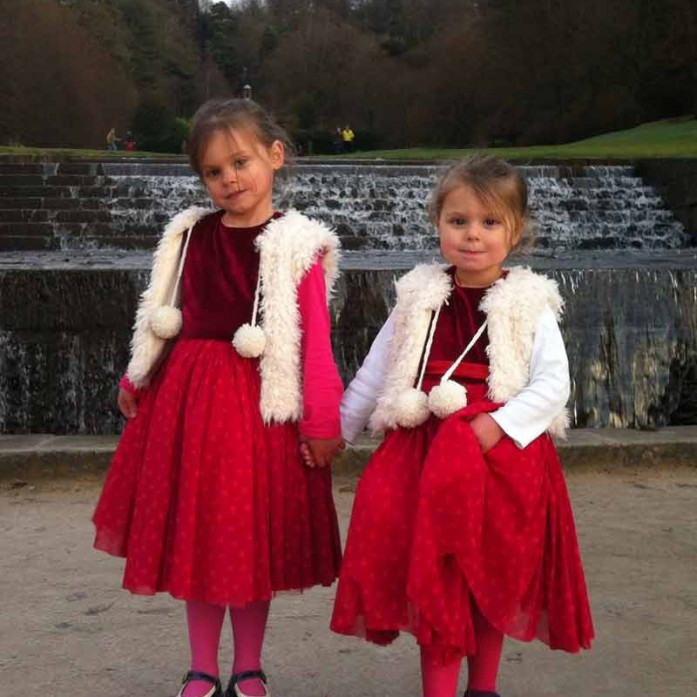 red velvet and tulle party dresses with yeti fur waistcoats