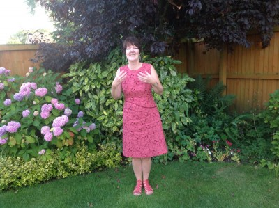 raspberry embroidered linen dress