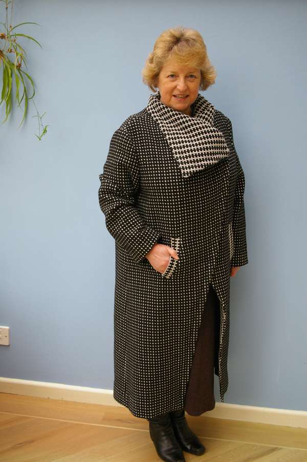 black and white coat with reversed contrast collar and pockets