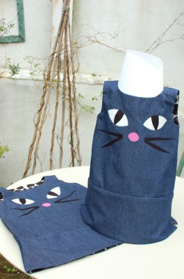 denuim dresses with embroidered pussy cat faces and glow in the dark eyes