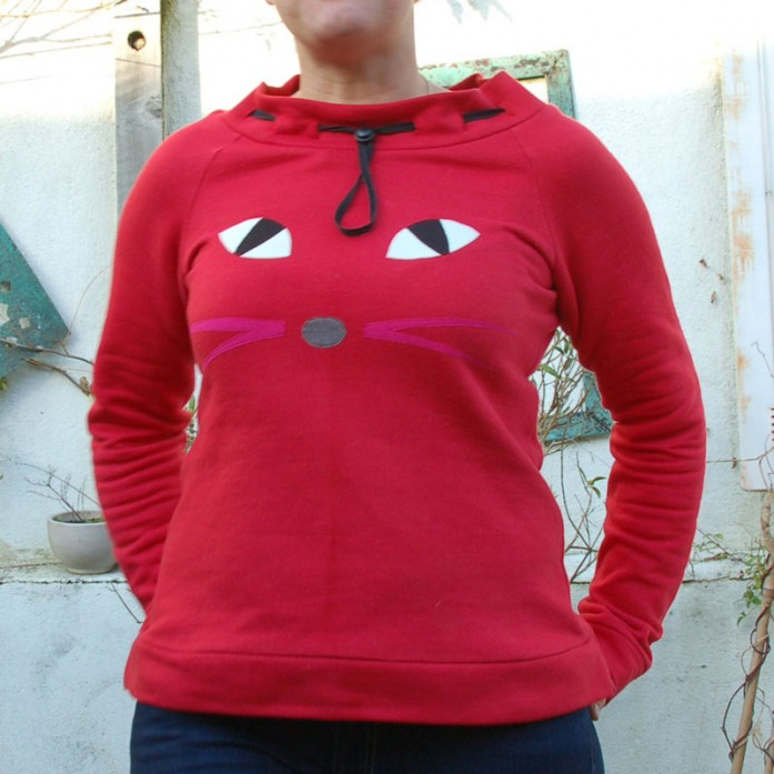 red sweatshirt with pussy cat eyes