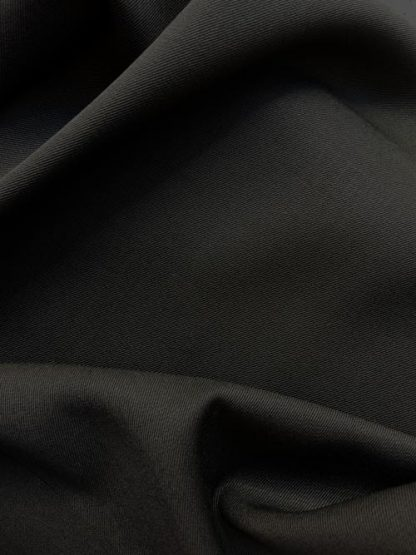 black 100% Wool worsted suiting fabric made in the uk