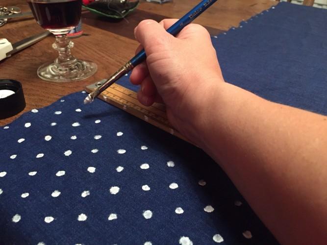 hand painting spots onto Irish Linen