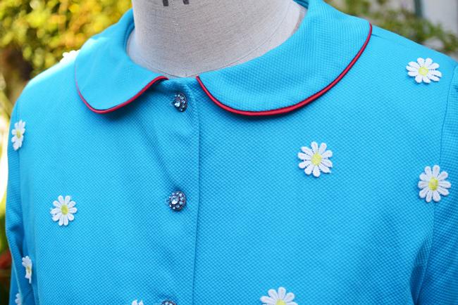 Peter Pan collar on turquoise piqué embellished coat