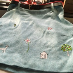 hand embroidered children's drawings onto wool tweed skirt