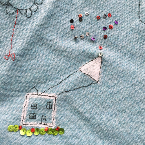 hand embroidered childre's drawings onto wool tweed skirt