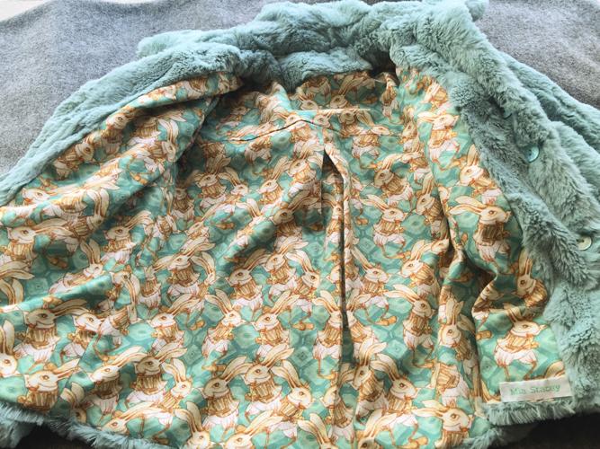 Child's fur coat with bunny rabbit print lining