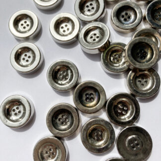 Silver vintage 1960's chunky 2 hole metal button. Due to age natural tarnishing of buttons cause colour variations