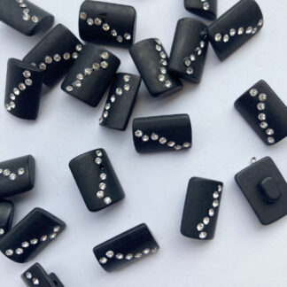Black oblong plastic button on shank with diamante