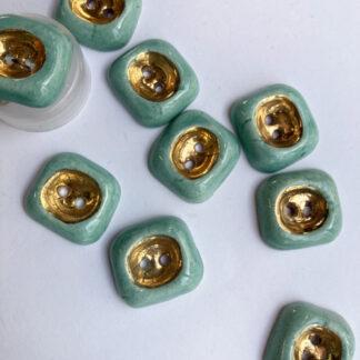 Aqua and Gold ceramic vintage thumb dent 2 hole button