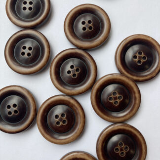 tan and dark brown traditional 4 hole coat button