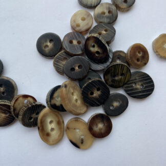 Brown and Beige Camel Horn Button **sizes and shapes can vary, these buttons are slices of natural horn**
