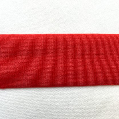 Red Lycra tape used for binding, stabilising and finishing