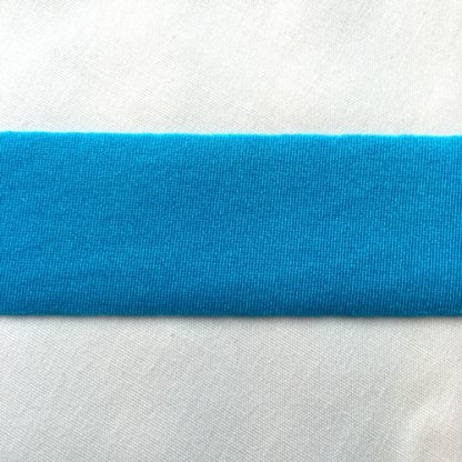 Electric Turquoise Lycra tape used for binding, stabilising and finishing