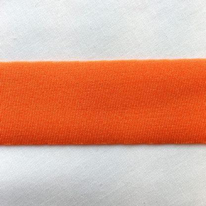 Orange Lycra tape used for binding, stabilising and finishing