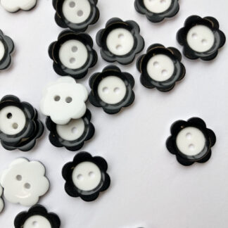 Black and White Mary Quant flower glossy plastic 2 hole button