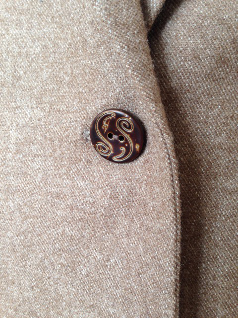 one button closure on tweed jacket