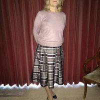 Christina wearing tartan silk flared skirt