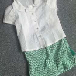 white cotton school shirt and green gingham school skorts