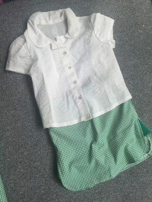 white cotton school shirt and green gingham school skorts