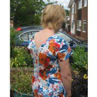 Orange and blue floral print stretch cotton sateen v-neck back dress