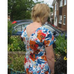 Orange and blue floral print stretch cotton sateen v-neck back dress