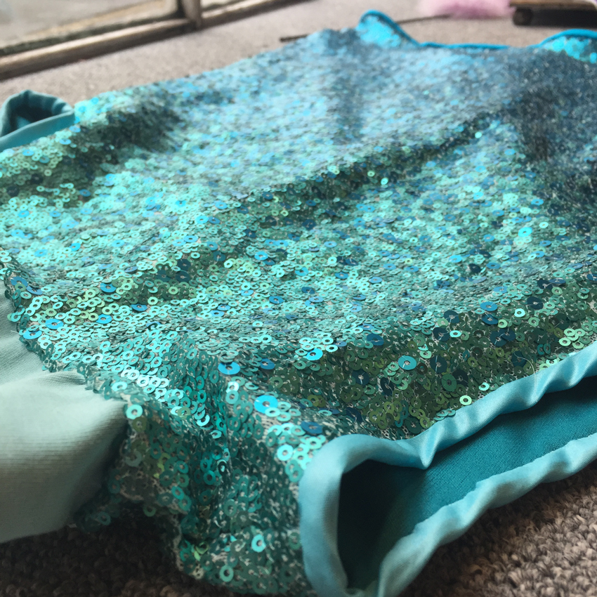 Turquoise sequinned tulle dress detail