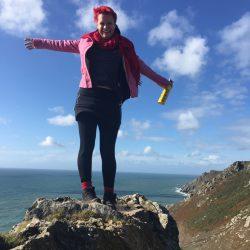 pink tweed coat on top of the devon cliff