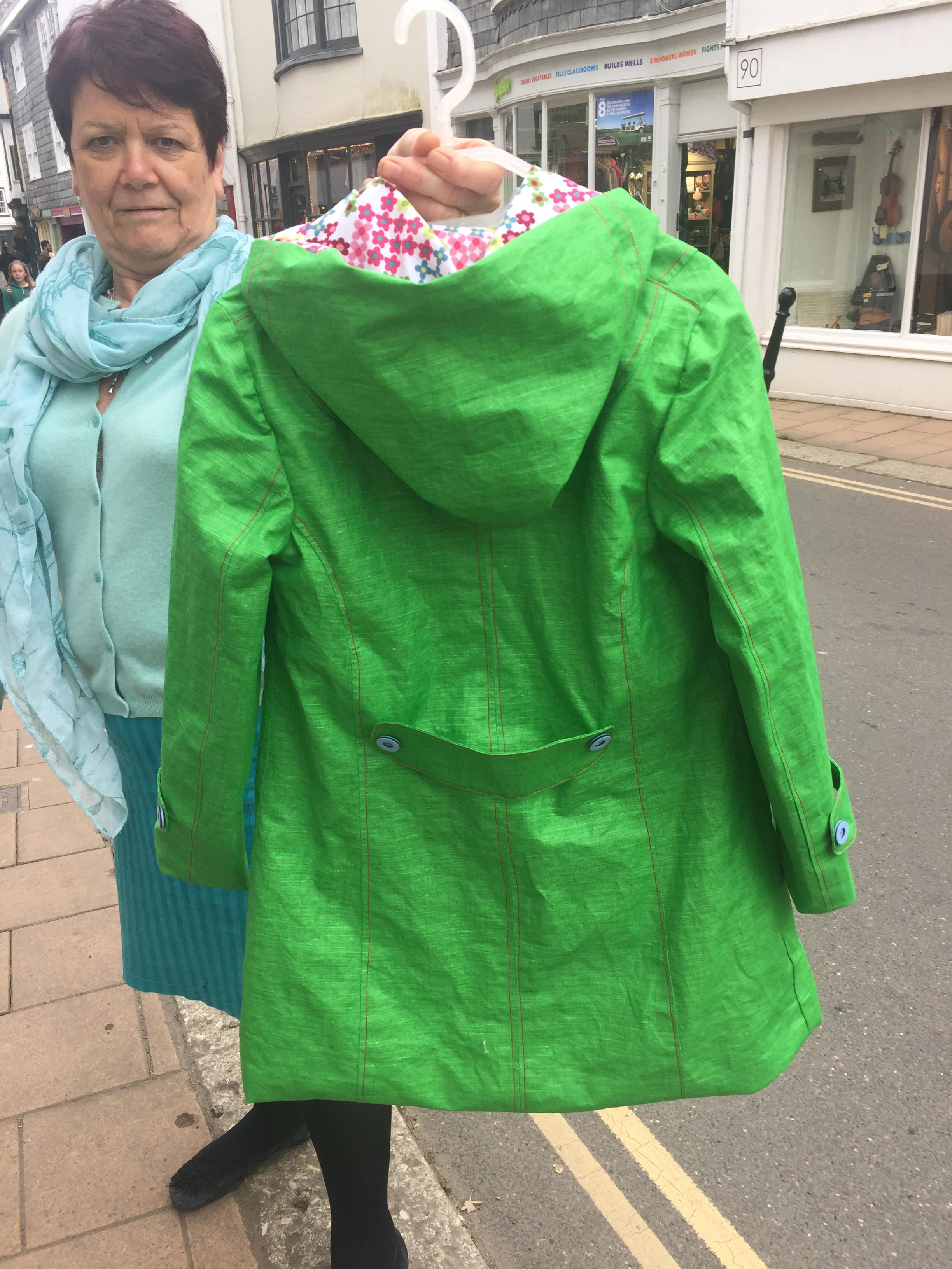 green proofed linen raincoat with pixel daisy organic cotton lining