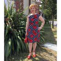 rose print on black and white spotty stretch cotton sateen dress