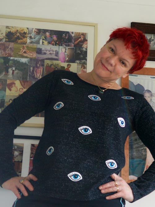 iron-on embroidered eye motif patches applied to black jumper
