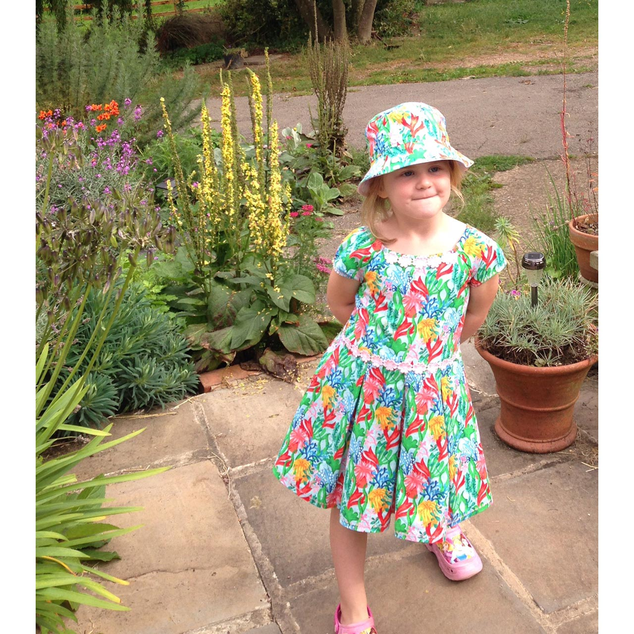seaweed and underwater print child's sundress and matching sun hat