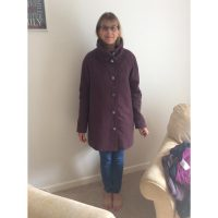 dusky purple wool melton coat with psychedelic print satin lining