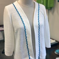 white linen jersey with sequinned rick rack trim