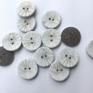 white sgraffito patterned wooden button