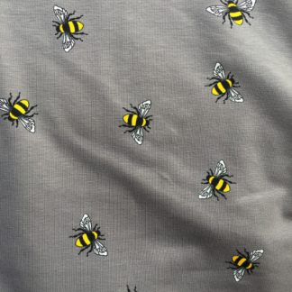 grey cotton jersey with random bee print