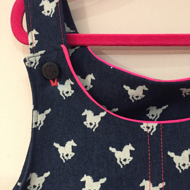 horse print stretch denim pinafore dress with pink trimmings