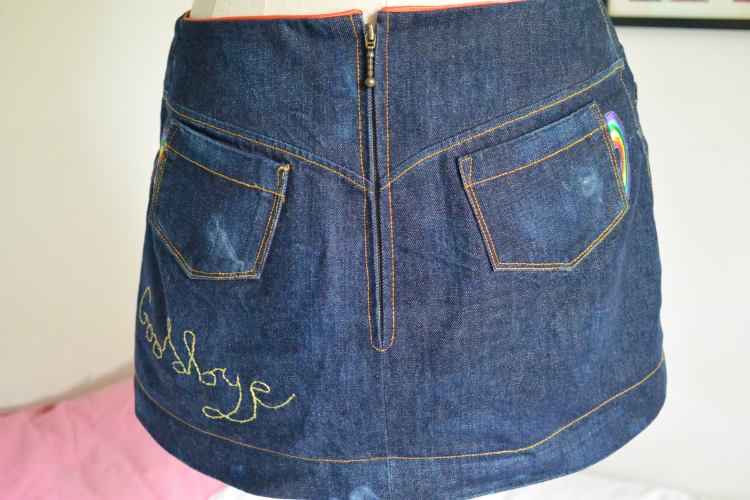 red selvedge denim mini skirt wirth rainbow patches (back view)