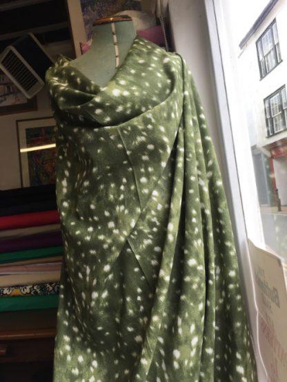 olive green animal print linen mix fabric