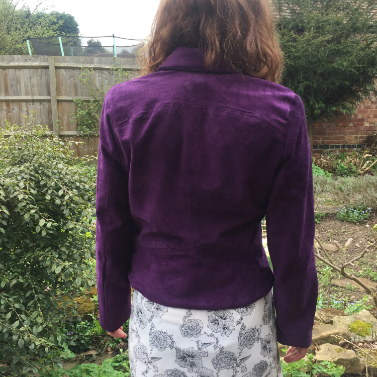 back view of purple suede jacket