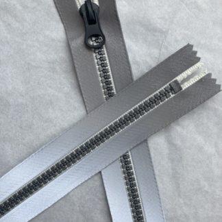 silver reflective moulded plastic teeth pocket zip