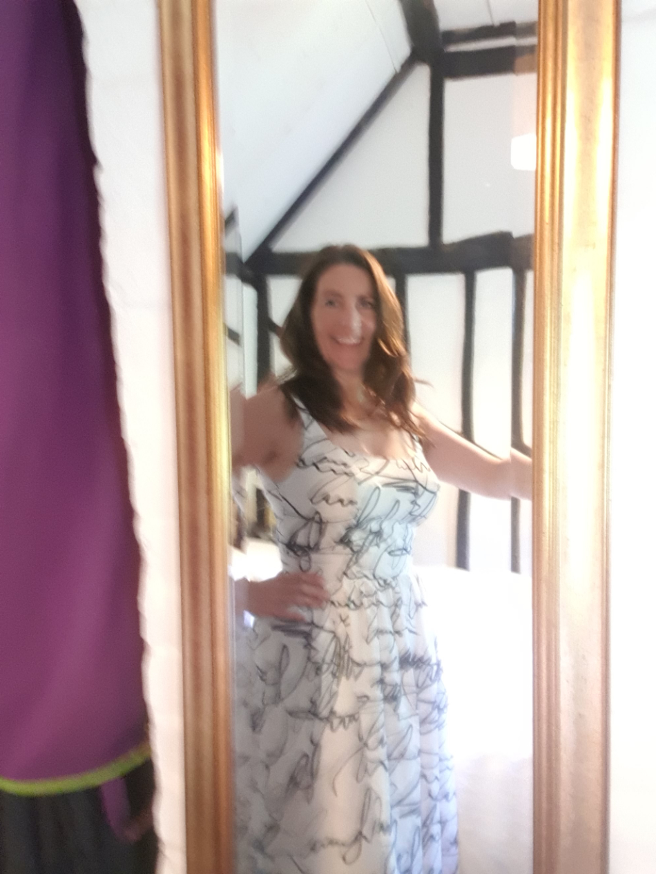 catharine in front of mirror wearing monochrome scribble print cotton voile dress