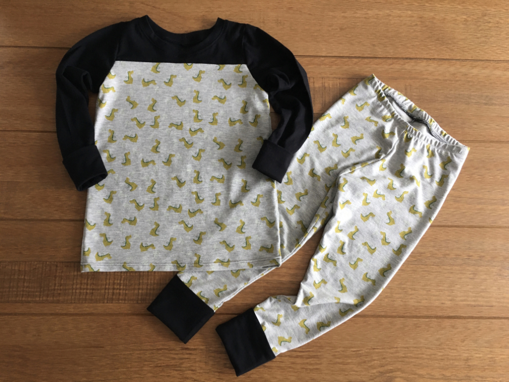 glow in the dark fire breathing dragons print pj's with black contrasting cuffs, sleeves and yoke
