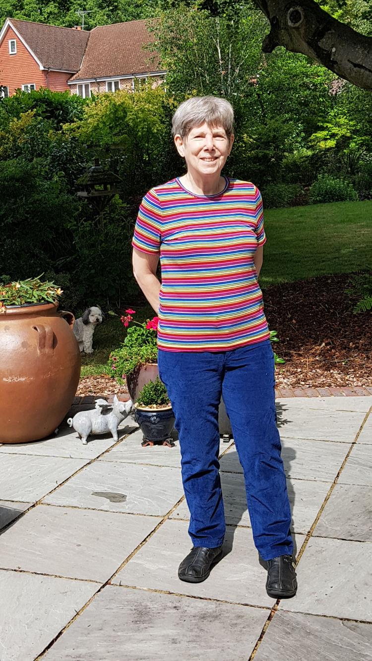 sally standing on patio wearing stripey cotton lark tee and crosscut stretch corduroy jeans
