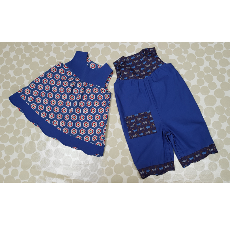 blue cotton romper suit and matching floral dress