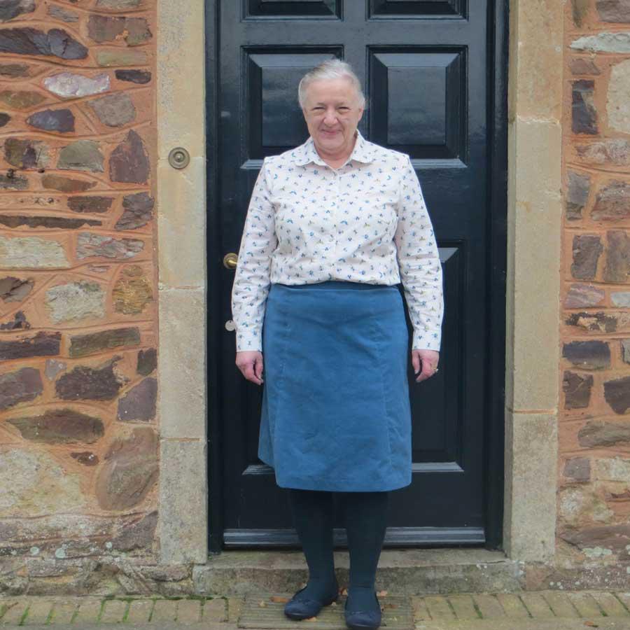 anne wearing handmade babycord skirt and poplin shirt