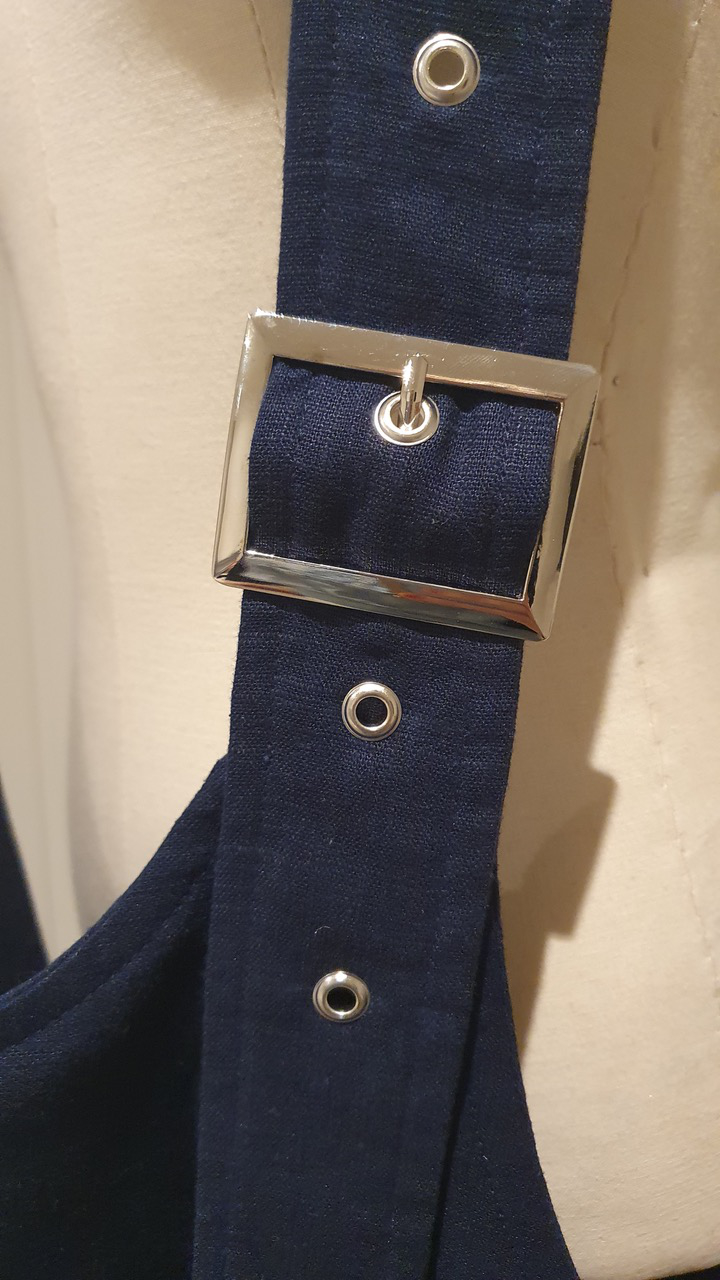 buckle detail with eyelet rivets