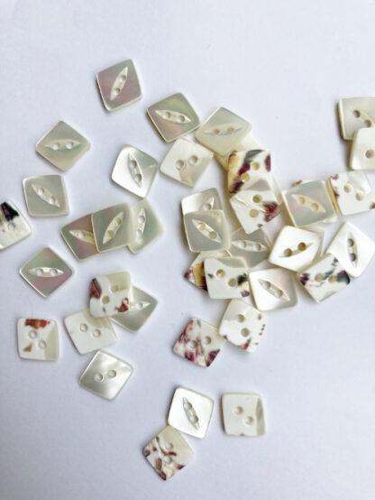 Natural Cream shell 2 hole diamond shape shirt button with fish eye